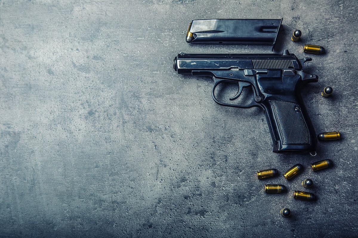 gun taken apart with stray bullets
