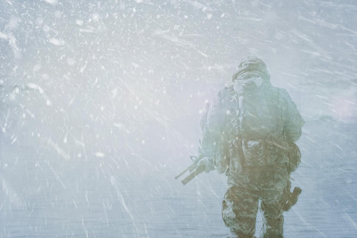 solider walking through snow