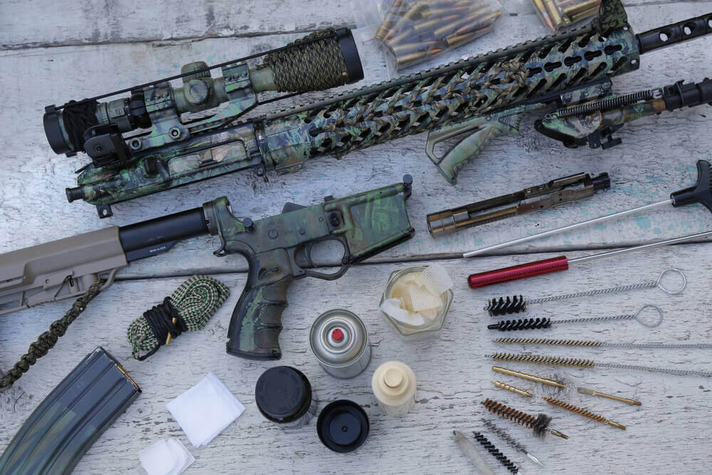 Disassembled gun parts and cleaning tools.
