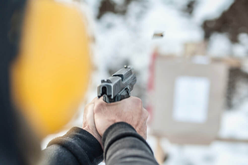 Person with gun at a shooting range