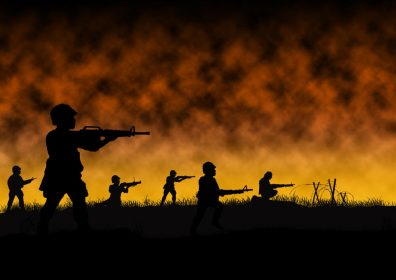 Silhouette of soldiers in war scene.